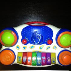 Orga muzicala Chicco, functioneaza pe baterii - Instrumente muzicale copii